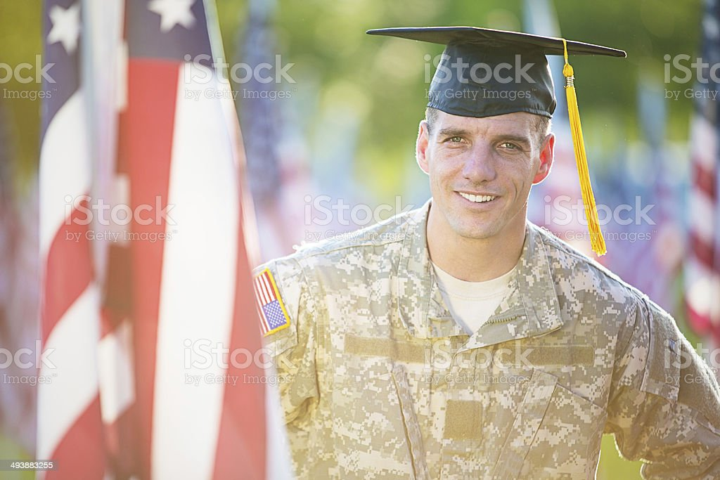 American Soldier with graduation hat stock photo