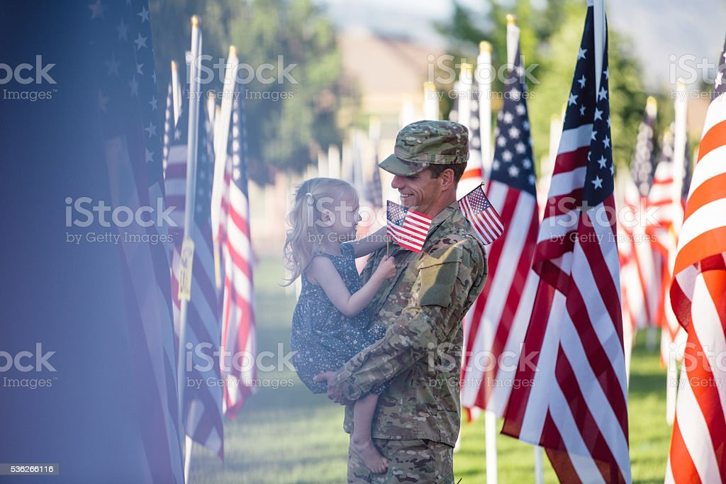 American soldier with his 3 year old daughter stock photo