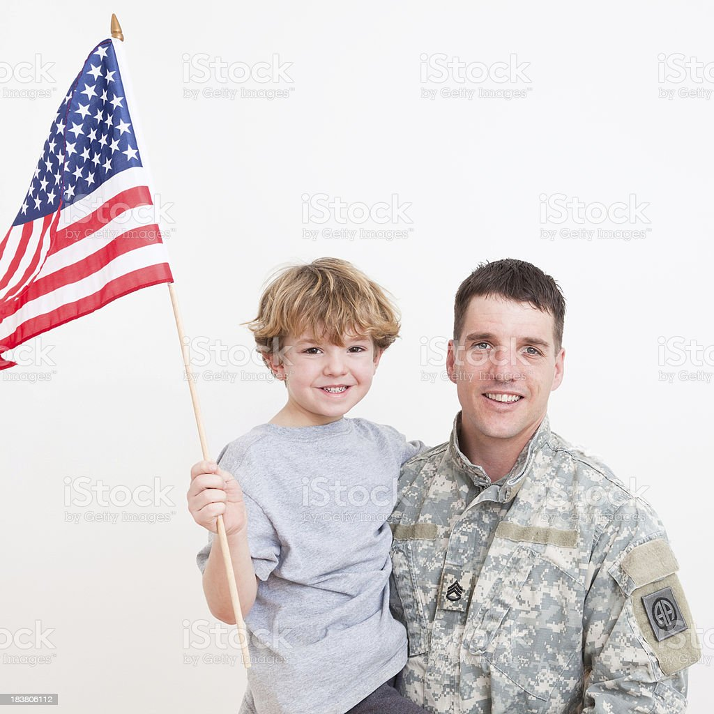 American soldier with his son royalty-free stock photo
