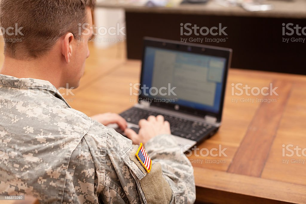 American soldier working on laptop stock photo