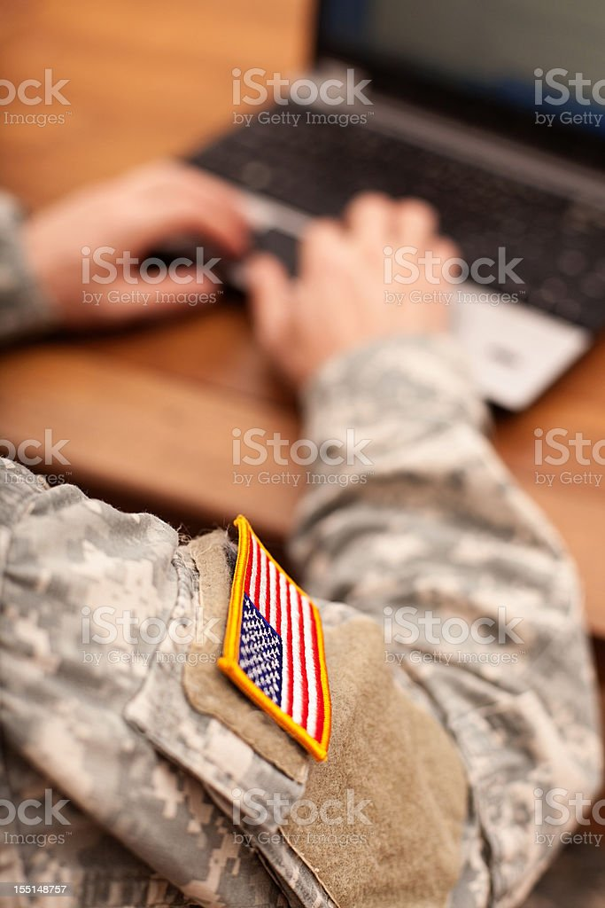 American soldier writing on a laptop stock photo