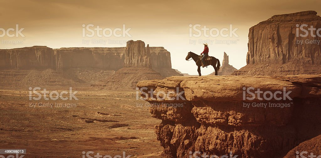 American Southwest Cowboy on Horse stock photo