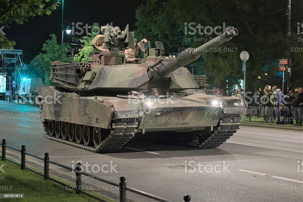 American tank driving on the street at night stock photo