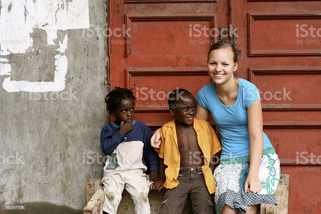 American Teen With African Children royalty-free stock photo