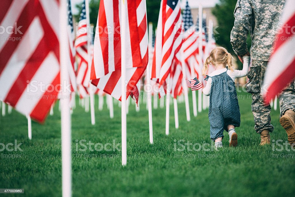 American toddler girl playing happily with her father stock photo
