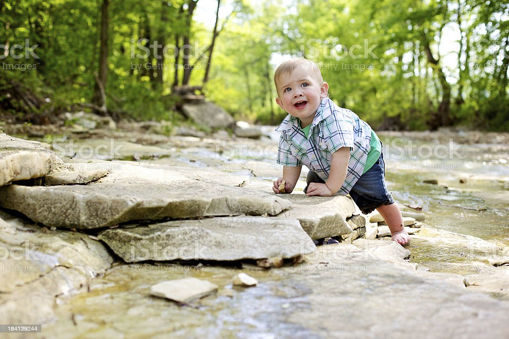 american toddler outdoors river adventure stock photo