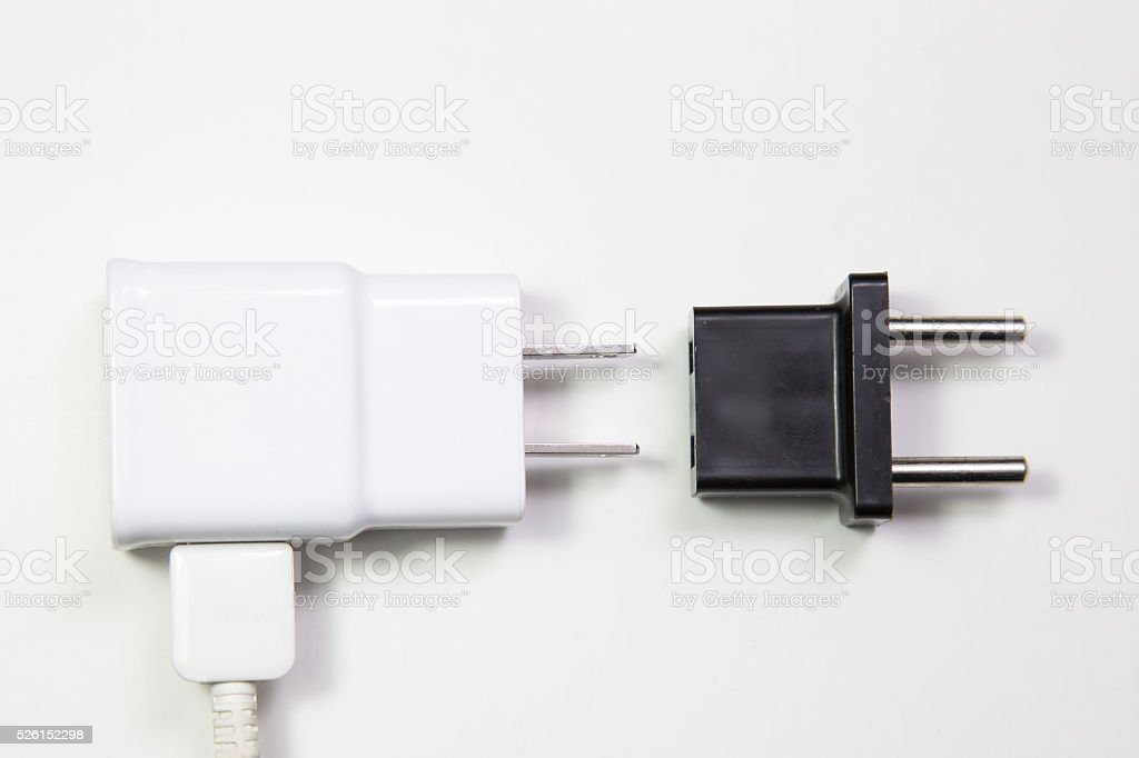 American type power cable plugged into white voltage converter stock photo