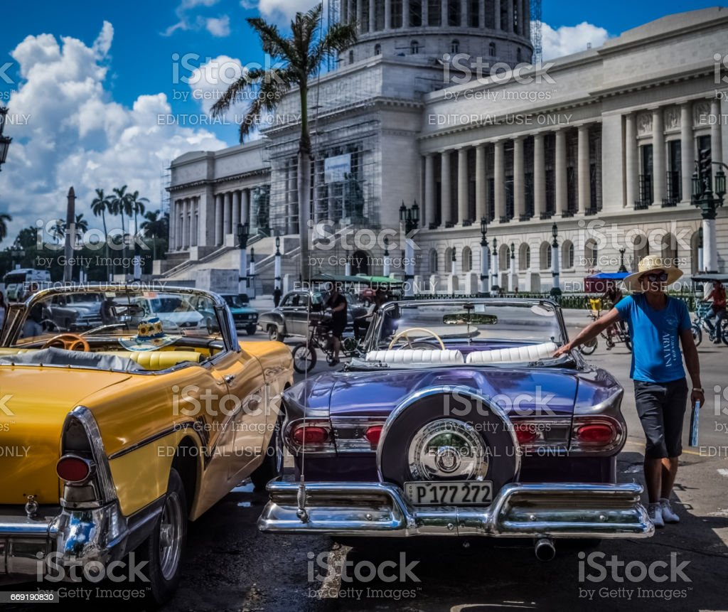 American vintage car with a cuban guide in Havana Cuba stock photo