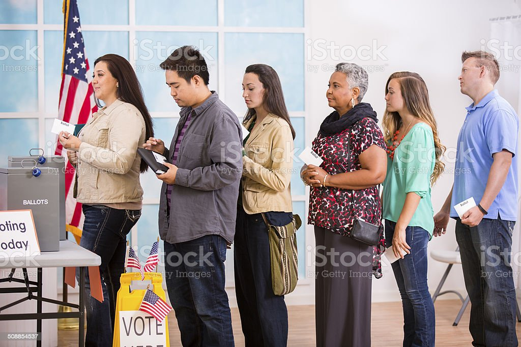American voters stand in line to cast ballots. November elections. stock photo