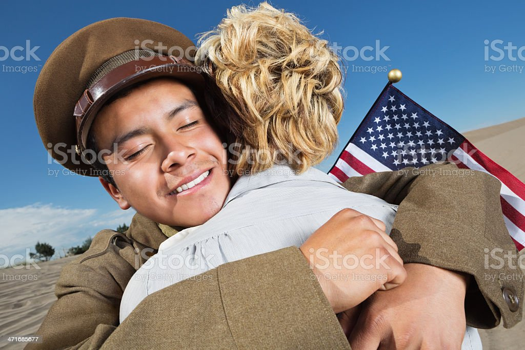 American war veteran being welcomed home by spouse royalty-free stock photo