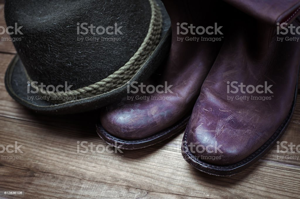 American West rodeo cowboy dirty and used brown boots and hat stock photo