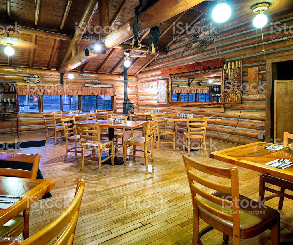American Western log cabin restaurant dining room interior stock photo