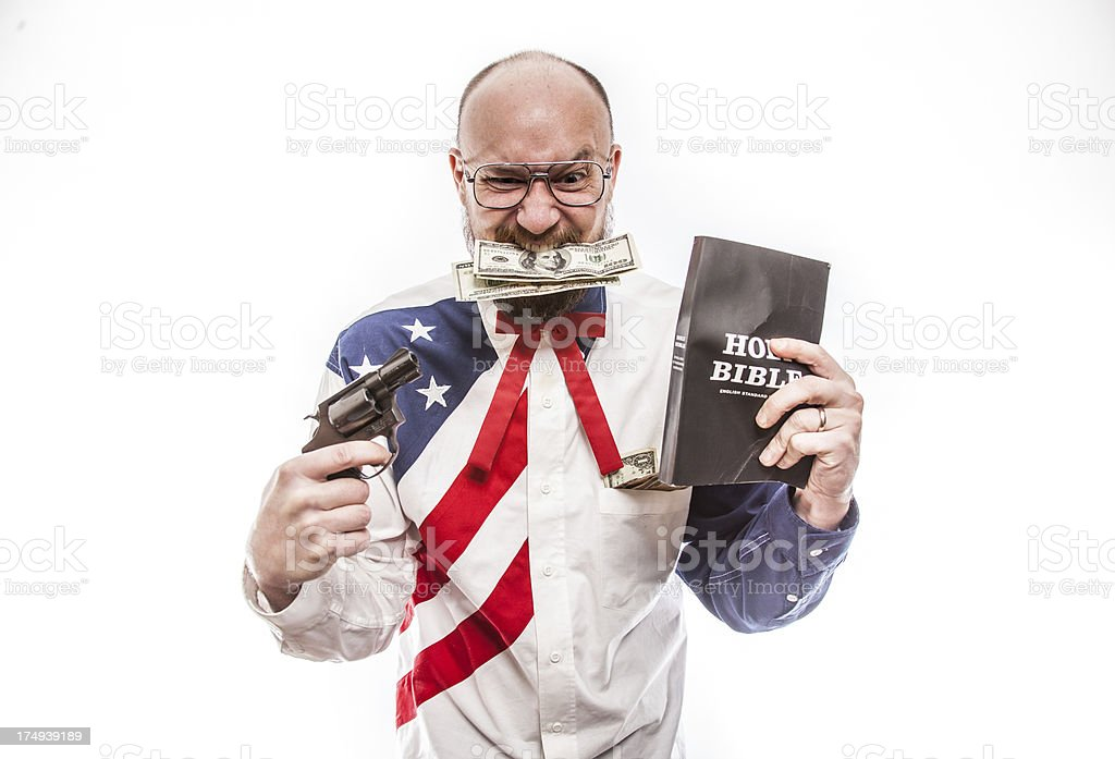 American with Gun the Holy Bible and US Bills stock photo