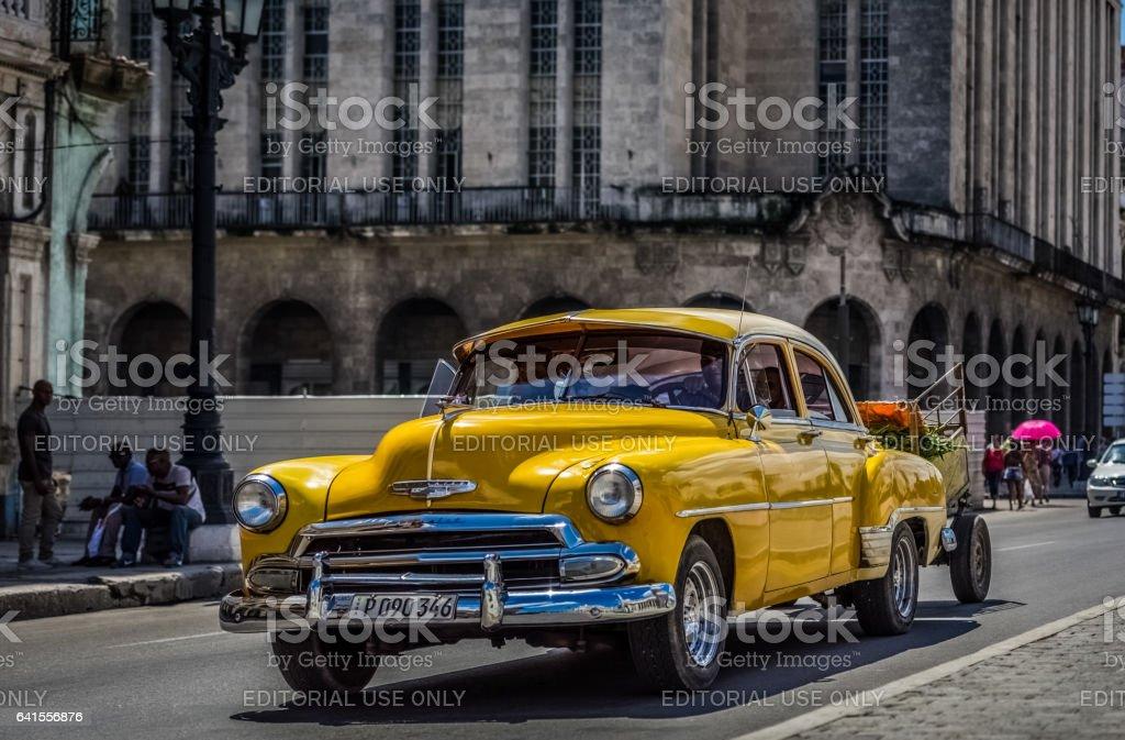 American yellow Chevrolet classic car in Havana Cuba stock photo