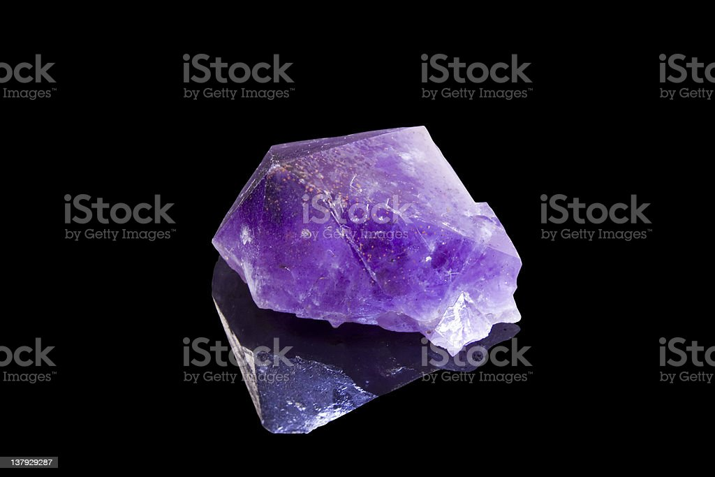 amethyst crystal over black background royalty-free stock photo