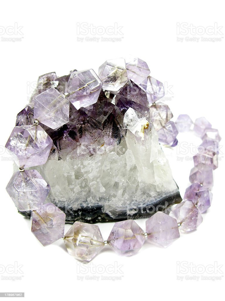 amethyst geode geological crystals and jewelery beads royalty-free stock photo