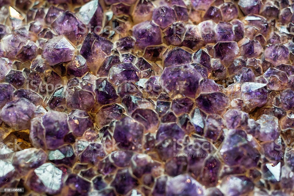 Amethyst is a violet variety of the mineral quarz stock photo