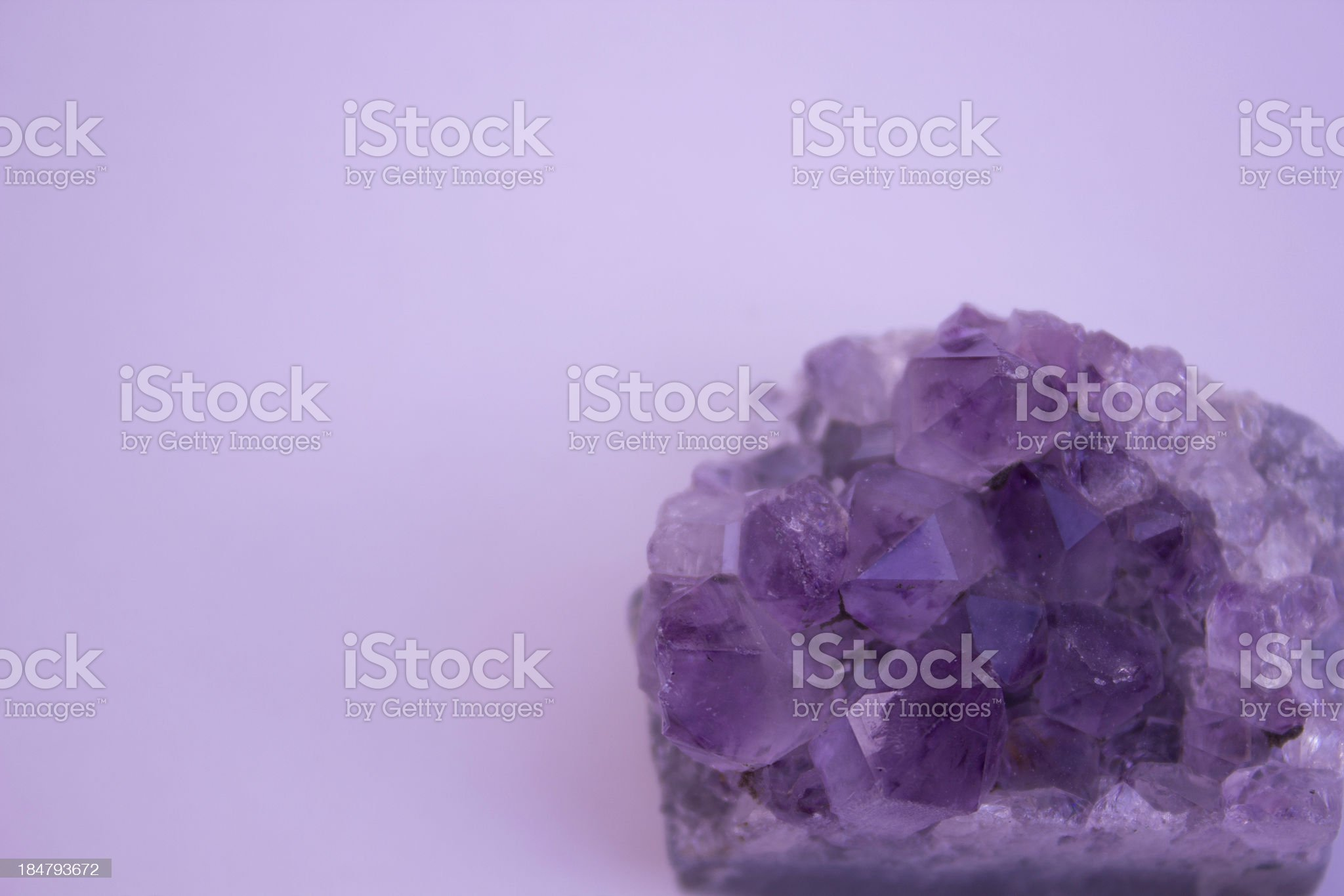 Amethyst On Purple Background royalty-free stock photo