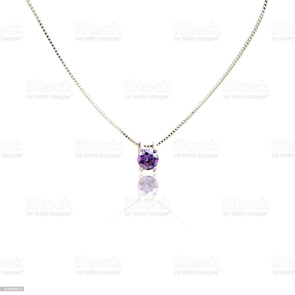 Amethyst pendant isolated on white stock photo