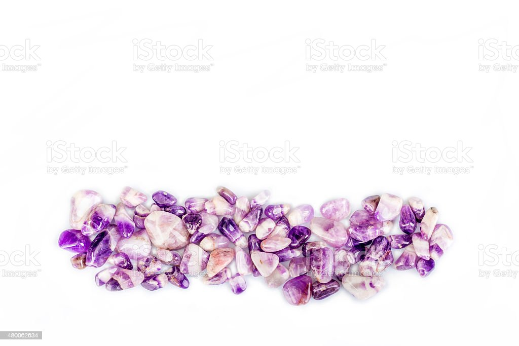 Amethyst quartz stones in a straight line stock photo