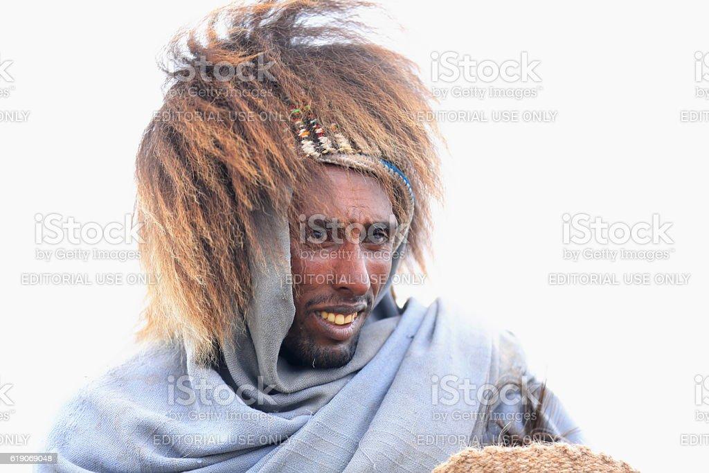 Amharic man-baboon gelada hair hat. Menelik's Window-near Debre Sina-Ethiopia. 0512 stock photo