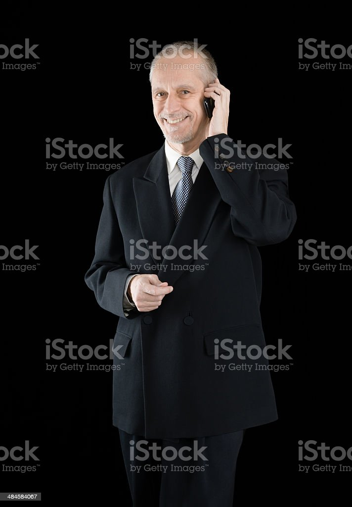 Amiable and Smiling Businessman on Phone stock photo