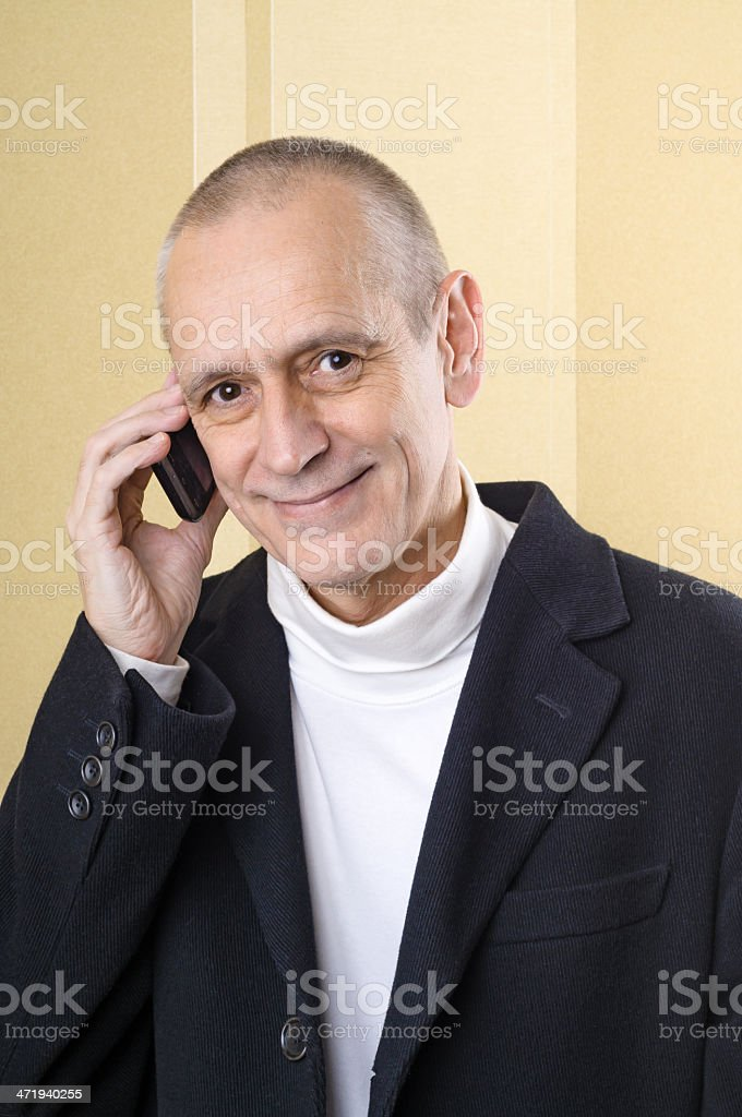 Amiable and Smiling Man on Phone stock photo