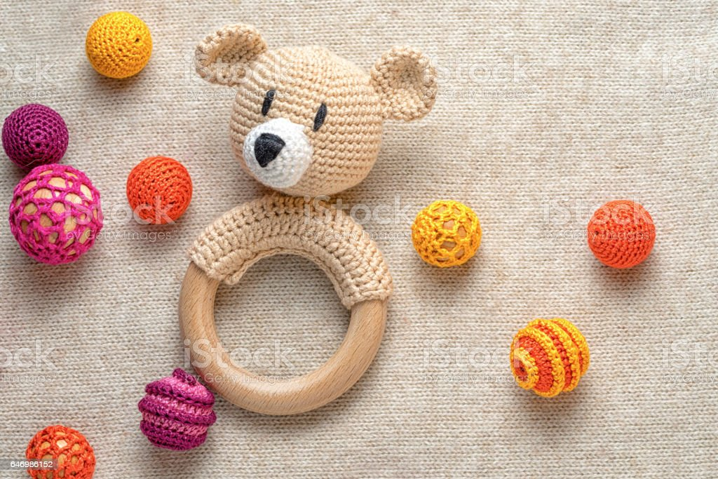 amigurumi toy bear and crocheted beads stock photo