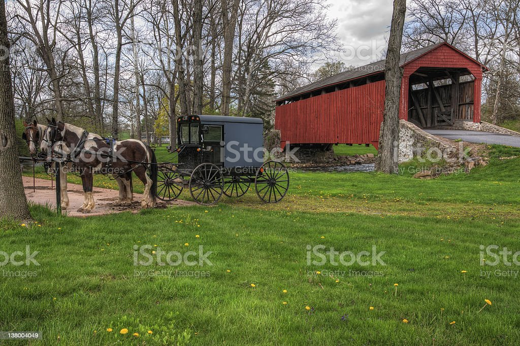 Amish Buggy Parked by Covered Bridge stock photo