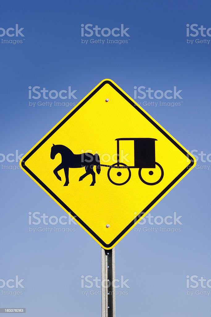 Amish Horse and Carriage Yellow Warning Road Sign, Blue Sky stock photo