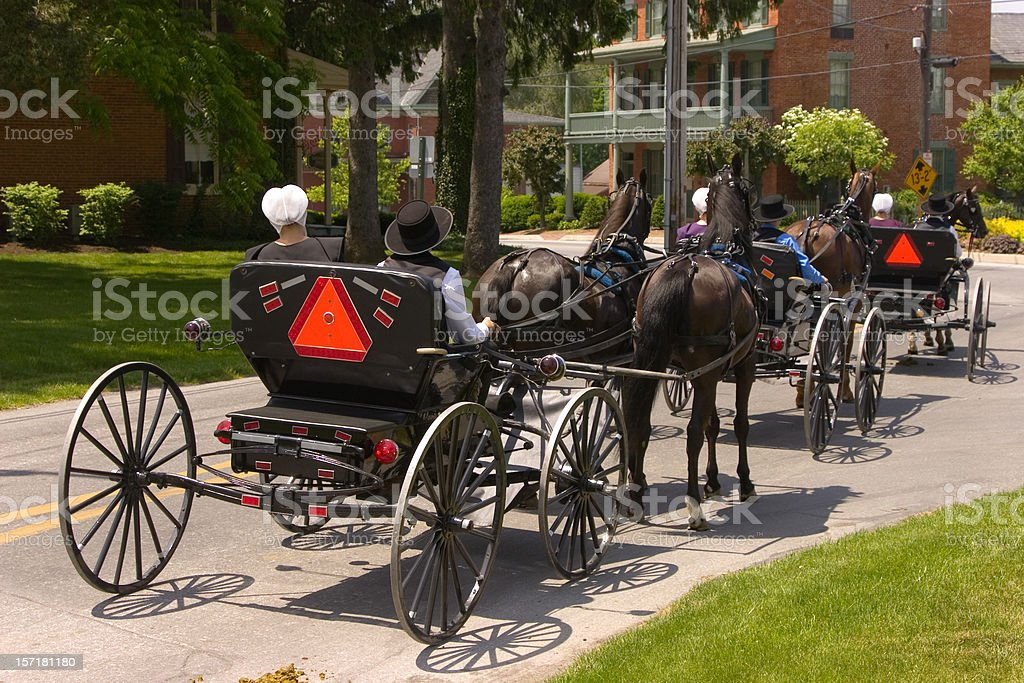 Amish in courting buggies stock photo