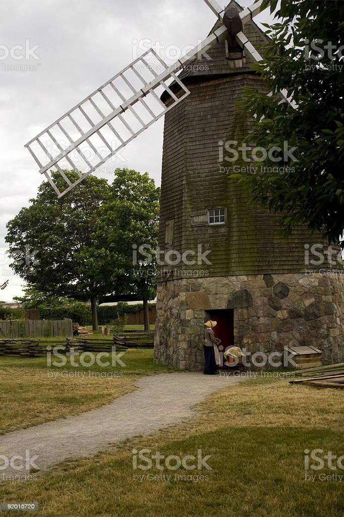 Amish Woman at the Cape Cod Windmill stock photo