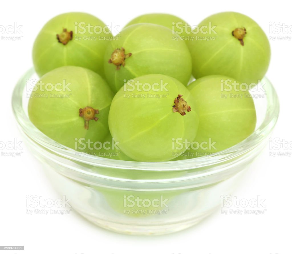Amla fruits in a glass bowl stock photo