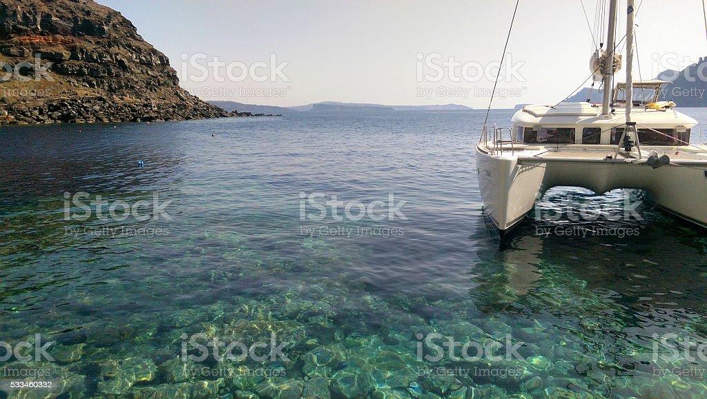 Ammoudi Bay Catamaran stock photo