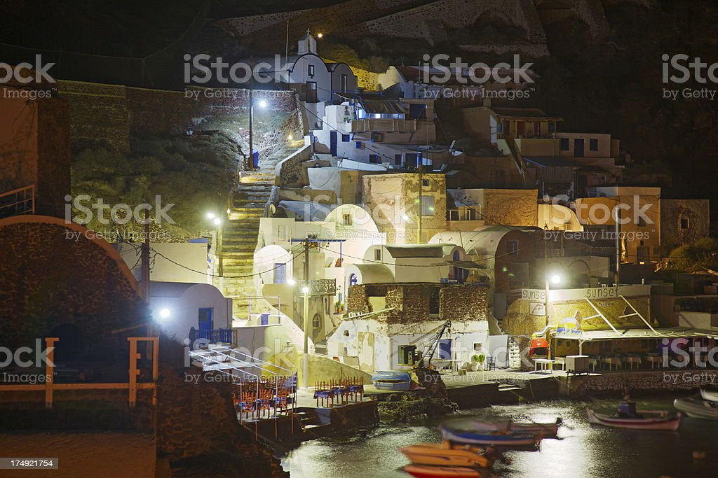 Ammoudi port view by night. Oia. Santorini. Greece. stock photo
