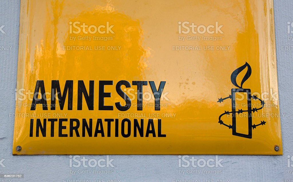 Amnesty international sign on a wall stock photo