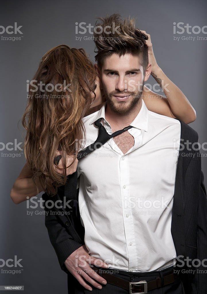 Amorous Couple on grey background royalty-free stock photo