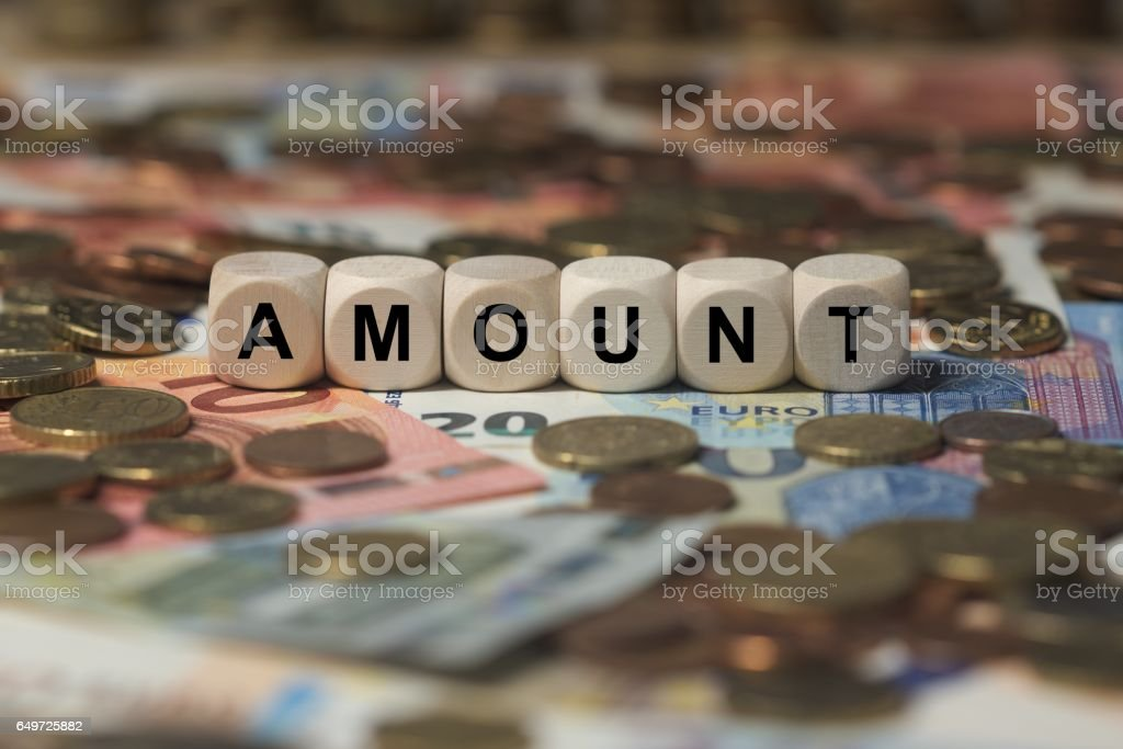 amount - cube with letters, money sector terms - sign with wooden cubes stock photo