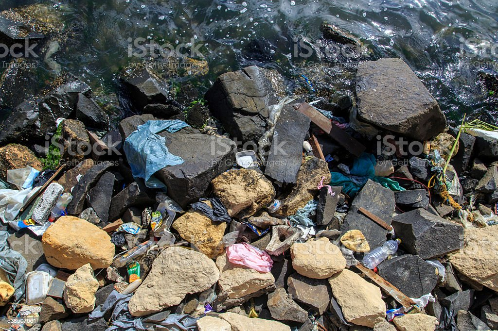 Amount of trash polluting river water stock photo