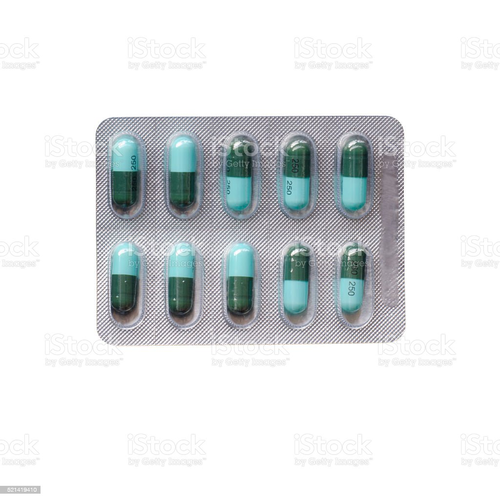 Amoxycillin capsule in blister pack isolated on white background stock photo