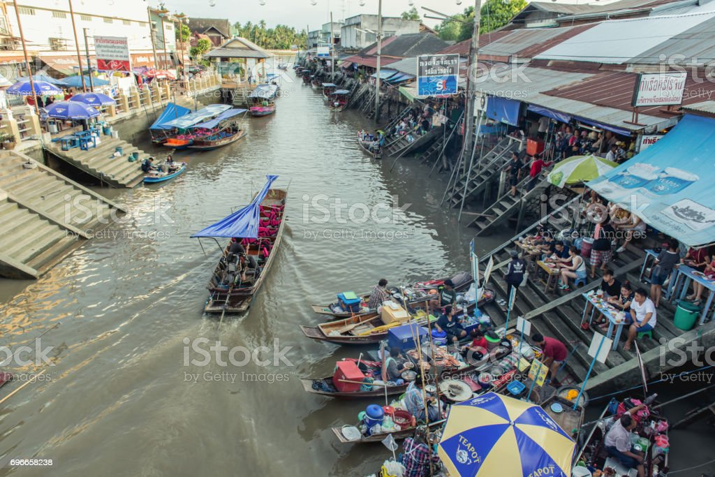 SAMUT SONGKHRAM, THAILAND- May 5, 2017: Ampahwa floating market on  in Samut Songkhram, Thailand. Amphawa is one of the most famous floating markets in the world. stock photo