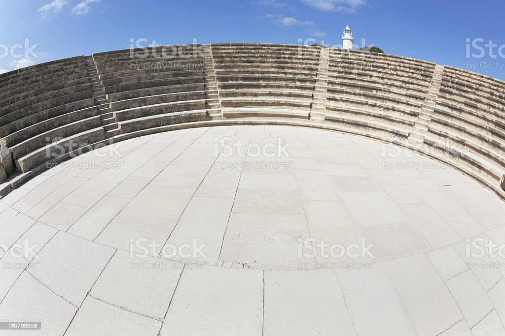amphitheater and Paphos white lighthouse against blue sky Cyprus royalty-free stock photo