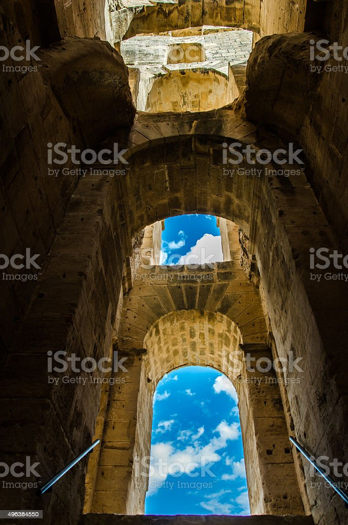 Amphitheater arches and sky, El Djem stock photo