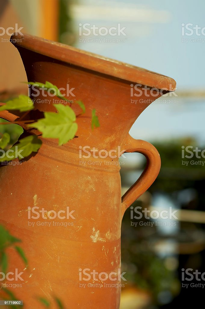 Amphora in the garden stock photo