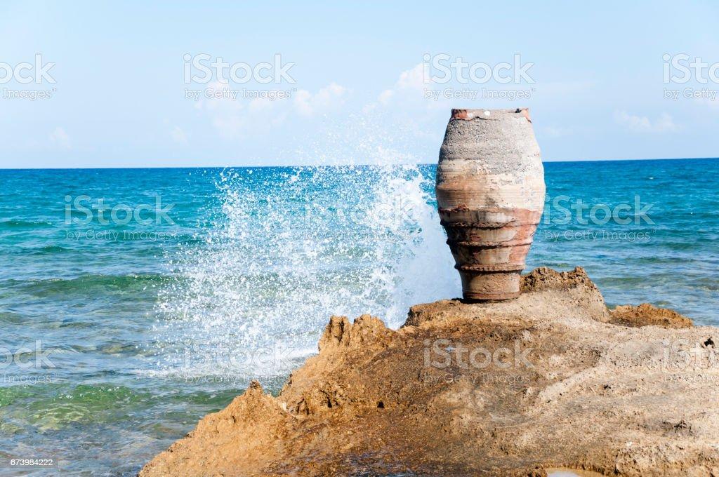 Amphora on the rocky beach stock photo