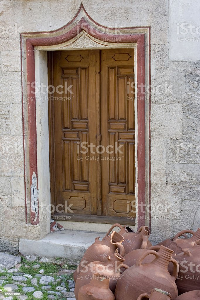 amphoras and old door stock photo