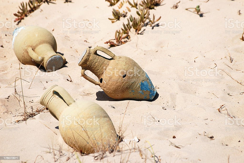 Amphoras lying in sand royalty-free stock photo