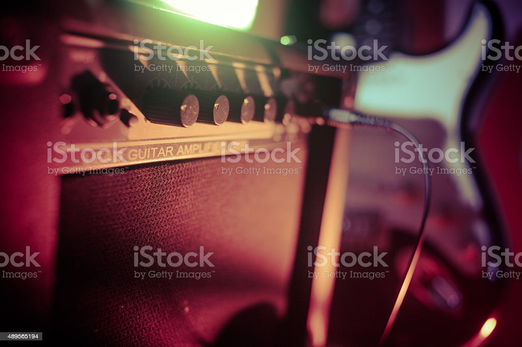 Amplifier and guitar stock photo