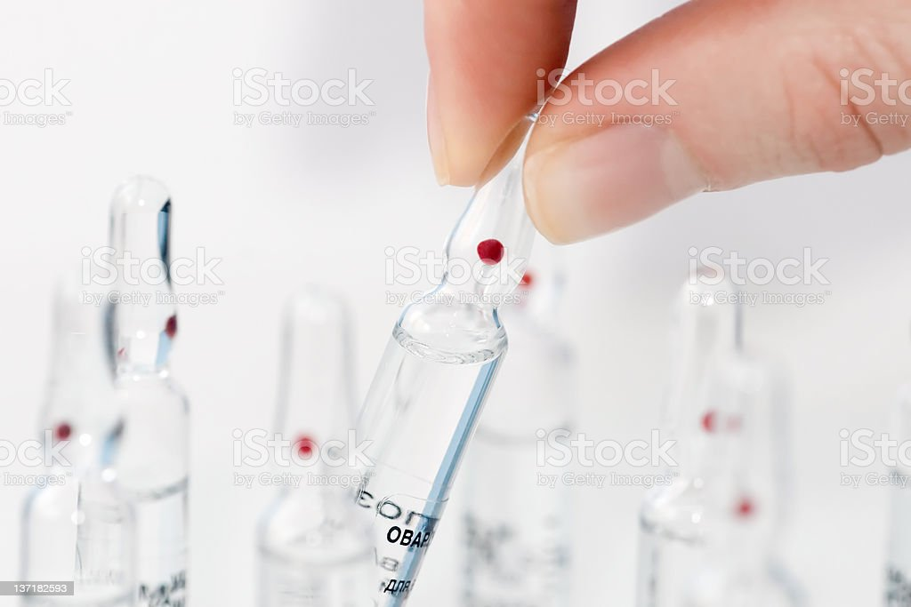 ampoule in hand stock photo