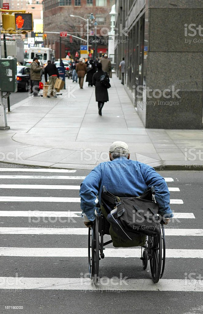 Amputee Crossing City Street royalty-free stock photo